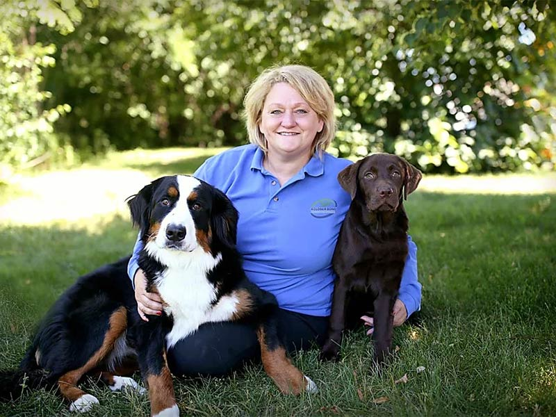 owner Katy Cushing with two dogs